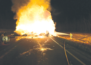 Big rigs collide, fire breaks out, highway closed