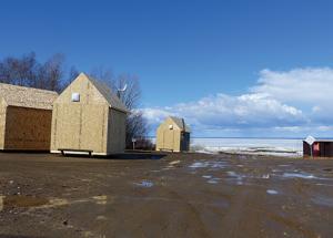 Fishing shacks removed in spite of weak ice on the shoreline