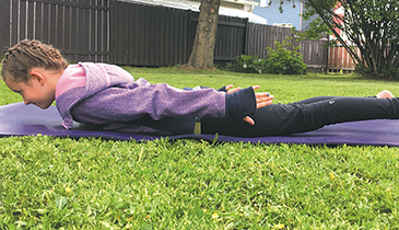 Strengthen spine, buttocks, arms and legs with 'locust pose'