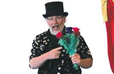Magician stuns kids at Library magic show