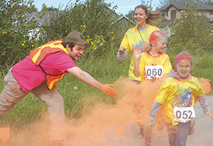 Runners get showered with powder at second annual Colour Rush Run