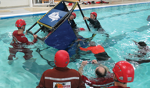 Firefighters and pilots get 'underwater egress' training