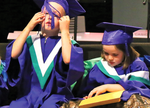Tiny grads celebrate in various ways