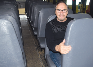 Students may have to buckle up on buses