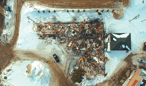 Derelict motel now a pile of rubble: who cleans it up?