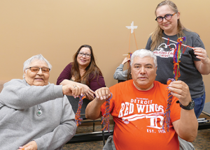 Métis finger weaving a traditional art form and cultural symbol