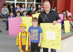 Sheets of praise, students thank community workers