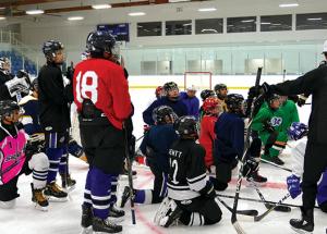 Deking, skating, and shooting: summer hockey camp.