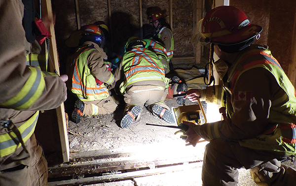 Two carpenters through a roof and in need of rescue